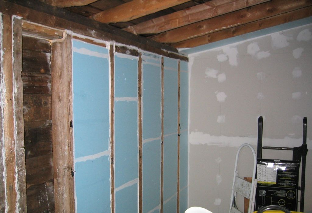 Insulating and drywalling back room